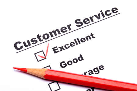 customer service survey with checkbox on form an red pencil photo
