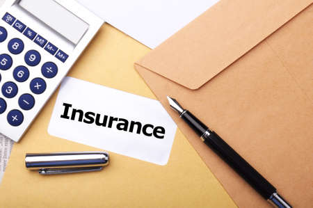 insurance concept with envelope showing risk concept