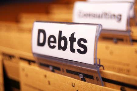debt management: dept word on business folder showing finance or financial concept