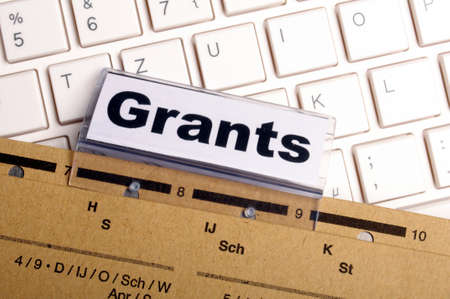 grants: grants word on paper folder showing scholarship or higher education concept