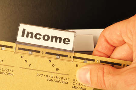 income word on business folder showing finance financial or earnings concept Stock Photo - 8469912