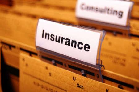 insure: insurance word on business folder showing risk management concept
