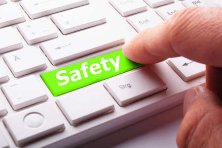 safety first on computer key showing security concept photo