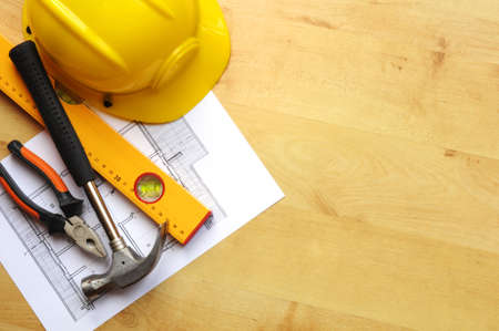 contractors: real estate concept with hard hat blueprints tools and copyspace