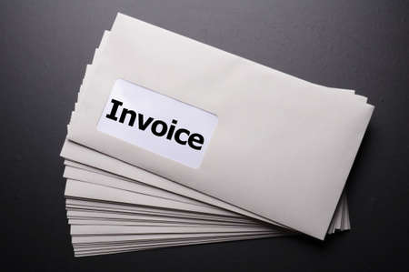 accounts payable: invoice mail concept with envelop showing business