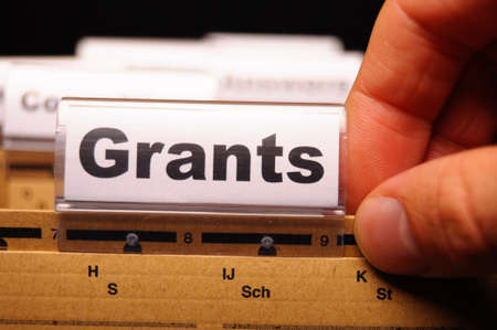 higher: grants word on paper folder showing scholarship or higher education concept