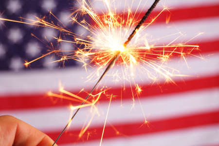 sparkler and usa flag showing 4th of july photo