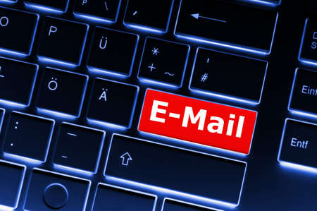email e-mail or internet communication concept with key on keyboard photo