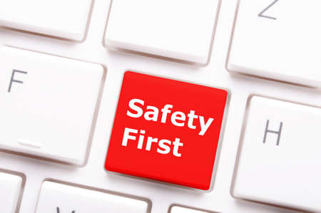safety first: safety first on computer key showing security concept