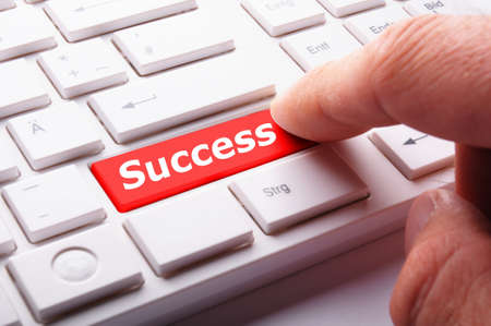 success word on button or key showing motivation for job or business photo