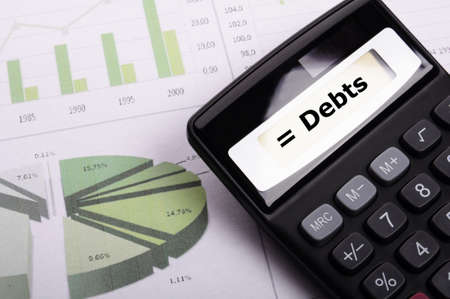 depts: financial debt or credit concept with calculatur