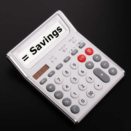 concpet: save money concpet with word savings on calculator Stock Photo
