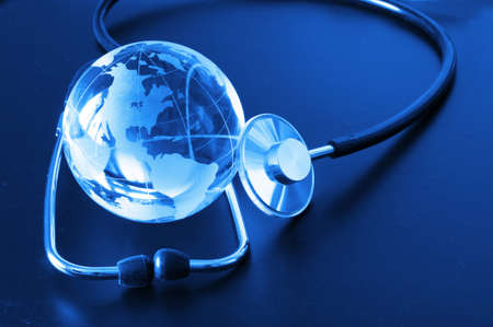 ecology eco environment or global warming concept with glass globe and stethoscope Stock Photo - 8578754