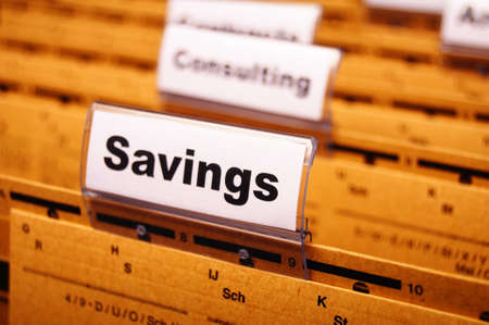 savings word on business folder showing saving money concept Stock Photo - 8578746