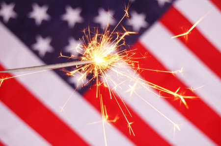 fourth of july concept with sparkler and usa flag photo