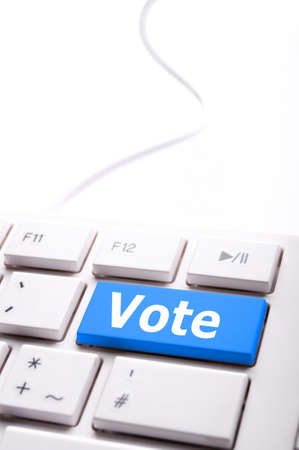 election concept with vote key showing poll polling or voting photo