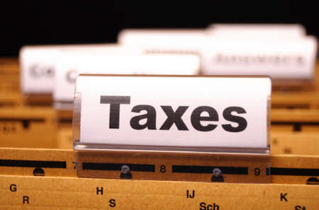 tax or taxes concept with word on business folder index Stock Photo - 8656704