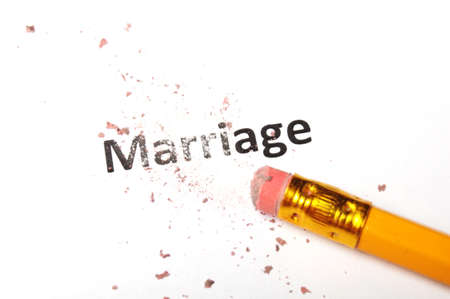 divorce concept with marriage word pencil and eraser photo