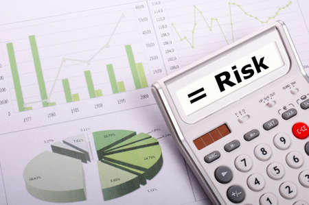 risk management concept with calculator showing financial success photo