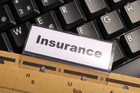 insurance word on business folder showing risk management concept photo