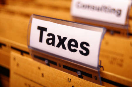 tax or taxes concept with word on business folder index Stock Photo - 8705493