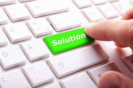 business solutions or problem concept with word on computer keyboard photo