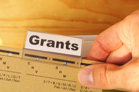 grants word on paper folder showing scholarship or higher education concept Stock Photo - 8777709