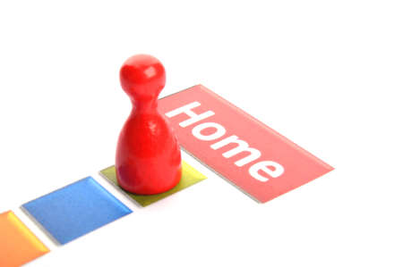 getting home concept with word and pawn on white photo