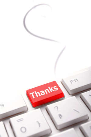 conputer: thanks or thank you concept with word on conputer key or button
