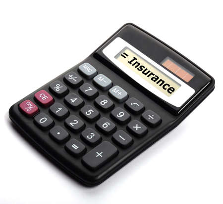 insurance or risk concept with calculator showing financial security photo