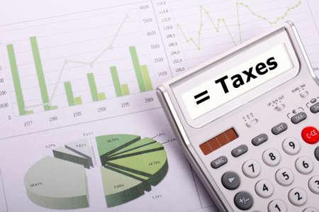 税または税概念ビジネス電卓と言葉 写真素材