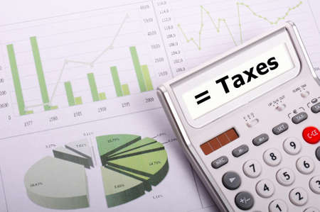 tax or taxes concept with business calculator and word Stok Fotoğraf - 8840867