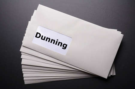 reminder concept: dunning or reminder concept with post letter and word