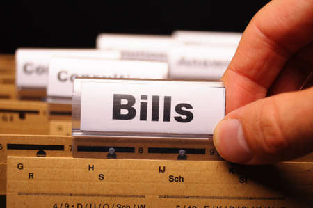 bill or bills word on paper riders showing payment or debts concept Stock Photo - 8840817