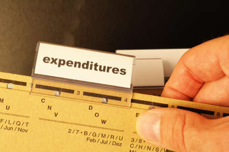 expenditures: expenditures word on business folder showing costs finance or investment concept