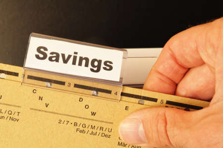 savings word on business folder showing saving money concept Stock Photo - 8840823