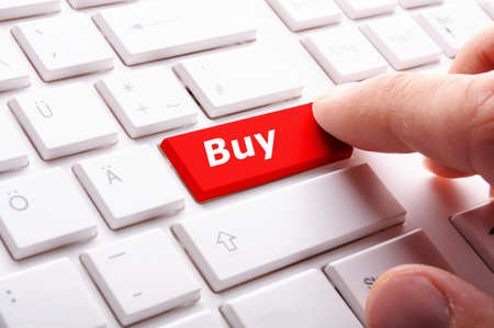 purchase order: buy key showing internet commerce or online shop concept
