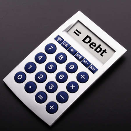 depts: financial debt or credit concept with calculatur