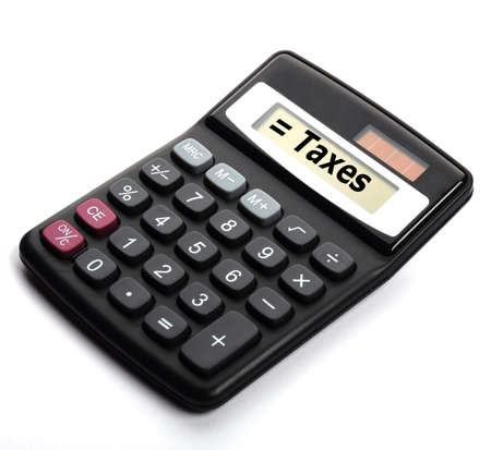 tax or taxes concept with business calculator and word Stock Photo - 8865522