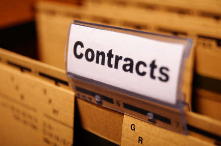 contract word on business folder showing trade or financial concept Stock Photo
