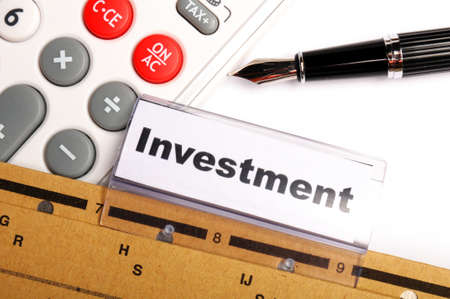 investment word on business folder showing financial success concept photo