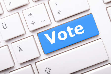 chose: election concept with vote key showing poll polling or voting