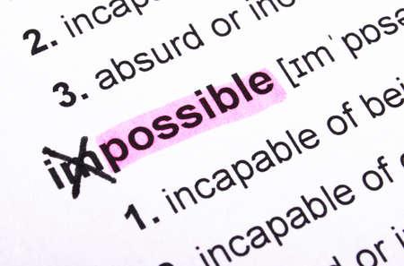 ontbering: mogelijk concept met word onmogelijk in woordenboek Stockfoto