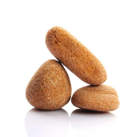 禅石または示すスパのコンセプトは白い背景で隔離の小石