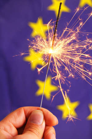 euro or european union flag and holiday sparkler showing celebration