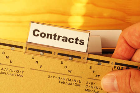 contract word on business folder showing trade or financial concept photo