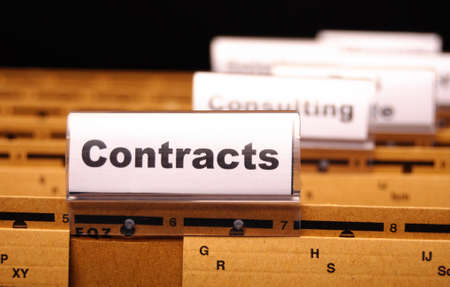 contract word on business folder showing trade or financial concept Standard-Bild