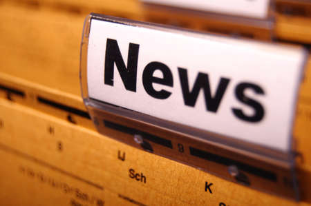 the latest: news or newsletter concept with word on folder register in business office