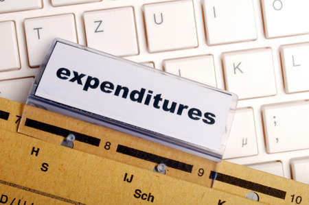 depts: expenditures word on business folder showing costs finance or investment concept