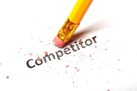 deleting: competition word and eraser on white showing business strategy concept Stock Photo